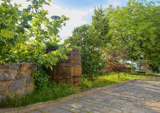Old wine press and rustic wine barrel. Wine background in Europe. Czech Republic, South Moravia.  stock photos