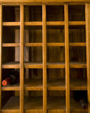Old Wine Rack With Two Bottles Stock Photography