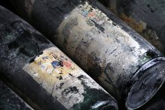 Murfatlar wine bottles very old, isolated close-up view of old label. Old wine, vintage bottles of Murfatlar from 1970`s, aging 30 years, black background stock images