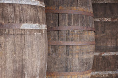 Old wine wooden barrels detail in a winery. Warm tone Stock Photo