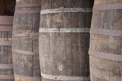 Old wine wooden barrels detail in a winery. Warm tone Royalty Free Stock Photos