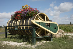 An old winepress decorated with flowers Royalty Free Stock Photos