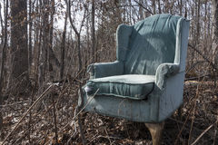 Old wingback chair in forest Royalty Free Stock Photography