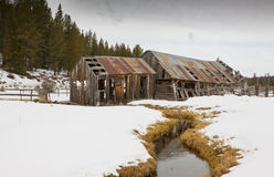Old Winter Barn with Stream Royalty Free Stock Photo