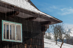 Old winter chalet in Czech Republic with snow melting Stock Image