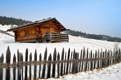 Old winter cottage with fence Stock Image