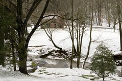 Old winter home. Creek with falls running behind an old home in the winter. A beautiful Christmas scene stock photos