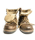 Old winter and mountain boots on white background Royalty Free Stock Photo