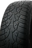 Old winter studded tire Royalty Free Stock Photo