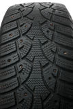 Old winter studded tire Royalty Free Stock Images