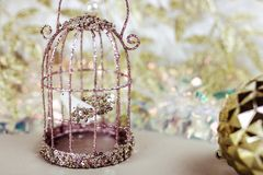 Old wire bird cage. Wedding background royalty free stock photo