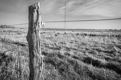 Old wire fence post Stock Photography