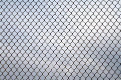 Old wire netting. Old metal wire netting on gry sky Royalty Free Stock Images