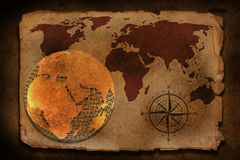 Old world map with compass. Old wire world map with compass on old paper twxture Royalty Free Stock Photo