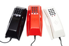 Old wired phones. Three old-fashioned plastic wired phones isolated on white royalty free stock photos