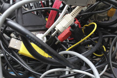 Old wires in a heap. cables chaos. A bunch of wires from the old electronics stock photo