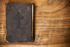 The old, wise book. Lies on a wooden background Stock Photo