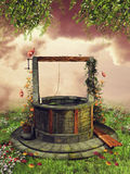 Old wishing well with spring flowers Stock Photos