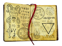 Old witch book with demon, fantasy and mystic symbols isolated on white Stock Photos