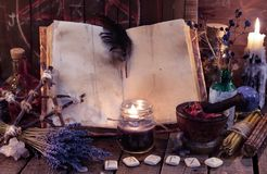 Old witch book with empty pages, lavender flowers, pentagram and witchcraft objects. Occult, esoteric, divination and wicca concept. Mystic and vintage stock images
