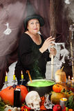 Old witch with a broom Royalty Free Stock Photos