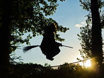 Old witch is flying on a broomstick Royalty Free Stock Images