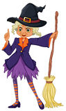 An old witch holding a broomstick Stock Photo