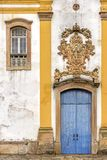 Old withe and yellow catholic church facade of the 18th century. Located in the center of the famous and historical city of Ouro Preto in Minas Gerais Stock Photo