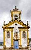 Old withe and yellow catholic church. Of the 18th century located in the center of the famous and historical city of Ouro Preto in Minas Gerais Royalty Free Stock Images