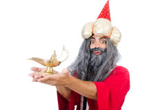 Old wizard with lamp Royalty Free Stock Photo
