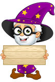 Old Wizard In Purple - Holding A Wooden Sign Royalty Free Stock Photo