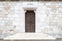 Free Old Woden Doors In Wall Of Massive Stones Royalty Free Stock Images - 138898529