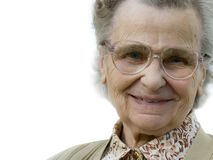 Old woman. With the eyeglasses smiling. isolated Royalty Free Stock Photography