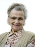 Old woman. With the eyeglasses smiling. isolated Royalty Free Stock Photos
