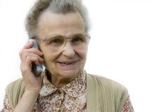Old woman. With the cellphone smiling Stock Photo