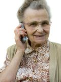 Old woman. With the cellphone smiling.Isolated Stock Photography