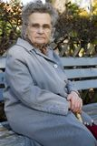Old woman. Elderly woman in the park Royalty Free Stock Image