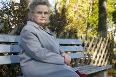 Old woman. Elderly woman in the park Royalty Free Stock Photo