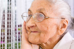 Old woman. At the window, dreaming the past Royalty Free Stock Photos