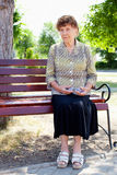 Old woman. In park. Happy senior woman Royalty Free Stock Images