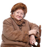 Old woman. In winter outwear over white background stock photography