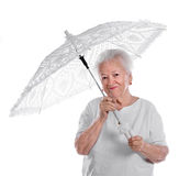 Old woman. Beautiful old woman with white umbrella on white background royalty free stock photography