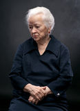 Old woman. Portrait of old woman on a gray background royalty free stock image