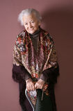 Old woman. With a cane on brown background stock photo