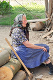 Old woman. A portrait with old woman and ax Stock Photos