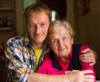 Old woman with an adult grandson. Stock Photography