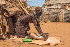 Old woman from the African tribe Dasanesh working in front of he Stock Photos