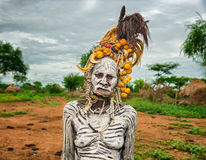 Old woman from the african tribe Mursi in her village royalty free stock images