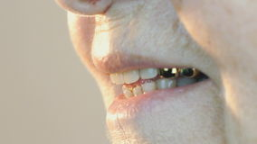 Old woman aged 80s smiling with false teeth stock footage