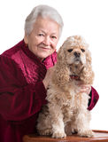 Old woman with american cocker spaniel Stock Image